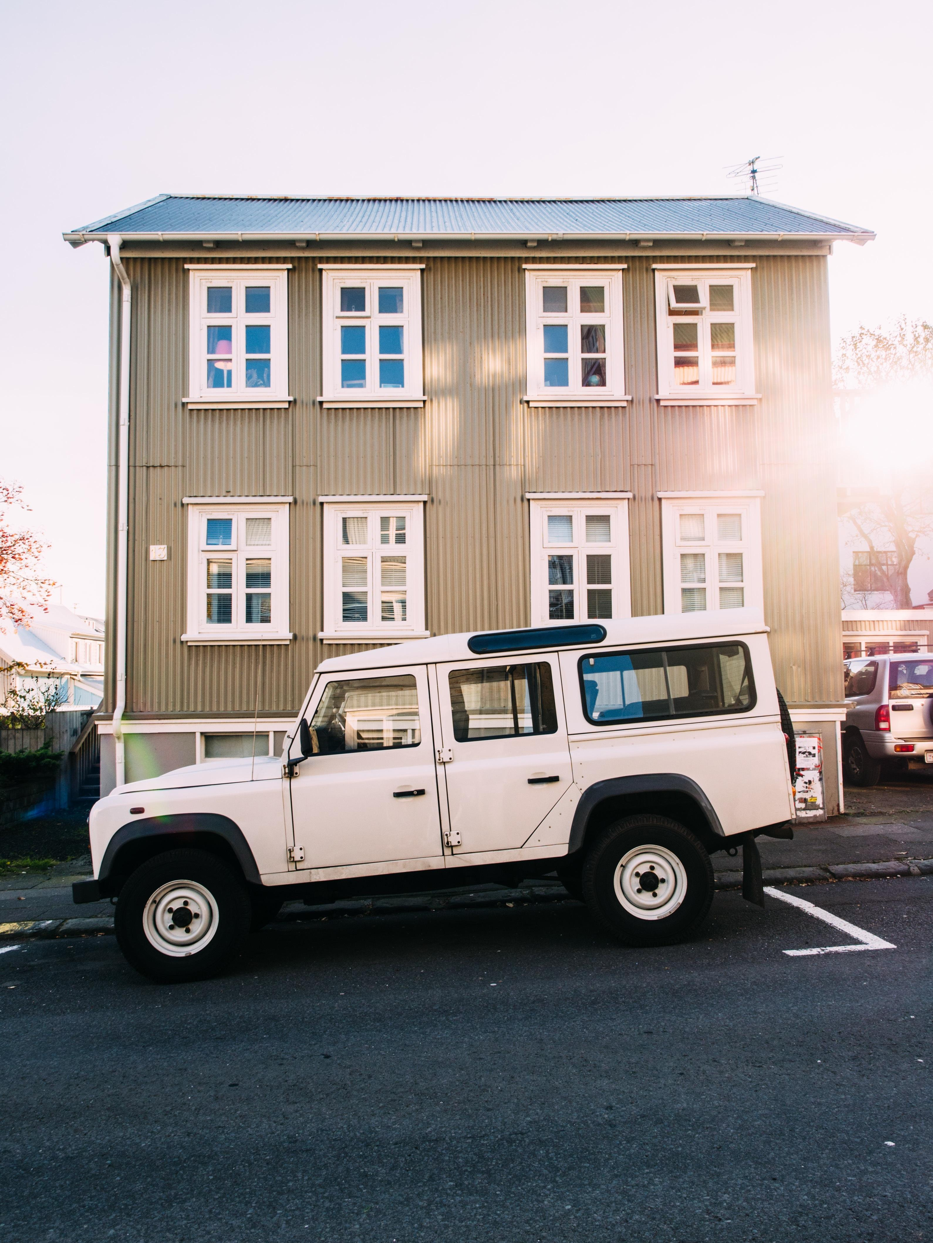 Land Cruiser in front of building